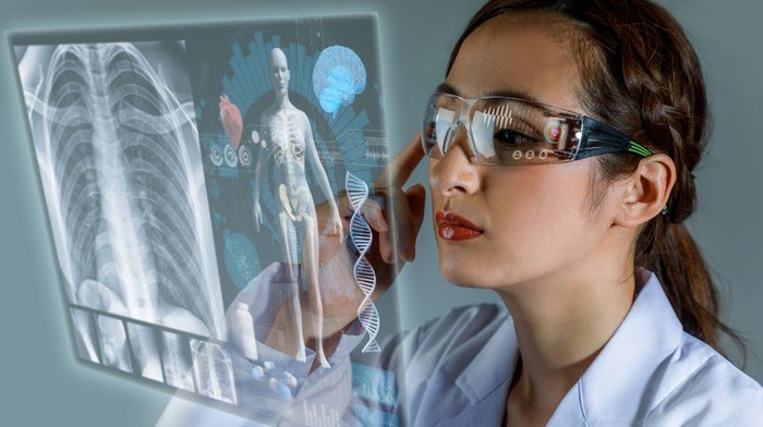 A young doctor uses a pair of AR glasses to view a patient's data.